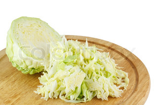 Cabbage cut into a wooden kitchen board