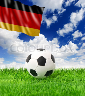 soccer ball on green grass and german flag