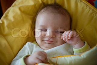 sleeping smiling newborn baby