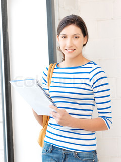 happy and smiling teenage girl with big notepad