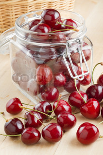 cherries in glass jar on kitchen table