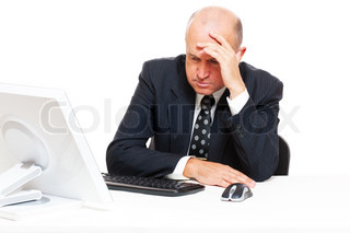 sad businessman sitting in office