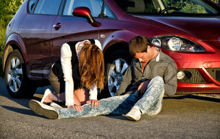 Woman and man on a road Concept car accident