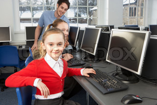 Girls using computers in school class