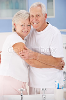 Senior couple hugging in bathroom