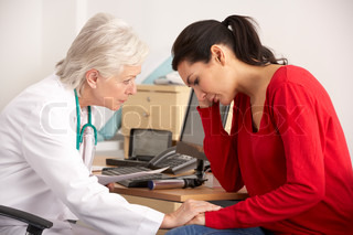 American doctor with depressed woman patient