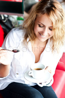 Beautiful woman in street cafe ,with cup
