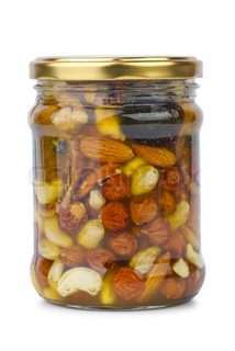 Glass jar with honey, nuts and figs