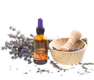 herbal lavender oil with dry flowers and mortar