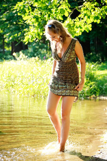 pretty girl walking on river shore