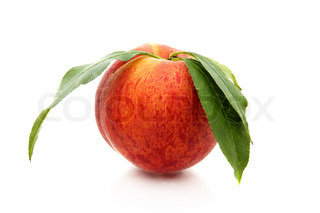 Ripe peach with green leaves