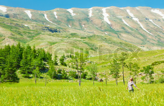 Happy healthy women over mountain landscape