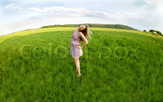 Young woman and green fields