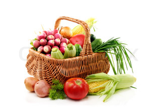 Vegetables in basket on a white background