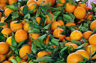 Fresh oranges for sale at grocery store Fruit background