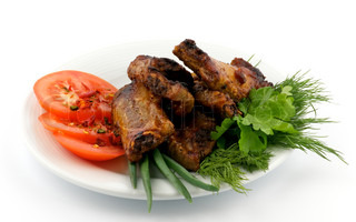 Barbecued pork ribs on white plate