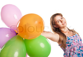 Cute teenage girl holding balloons on white