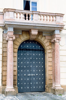 Traditional medieval door with columns and balcony