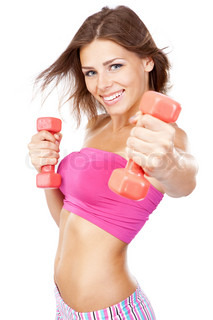 Beautiful slim woman with dumbbells