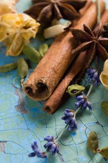 Herbal aroma composition of spices and dried fruits on the vintage wooden surface