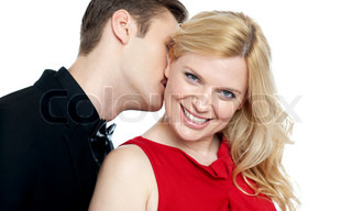 Closeup of young man kissing his lovers neck