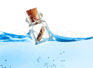 Bottle with help message floating in water