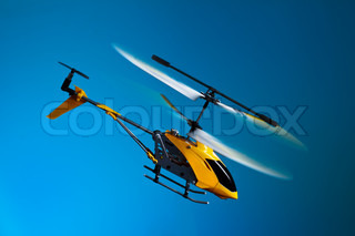 Flying remote controlled helicopter