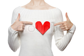 Girl pointing to origami heart