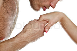 Man kissing woman's hand Isolated on white