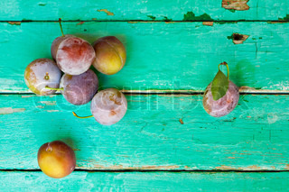 plums on old turquose color surface