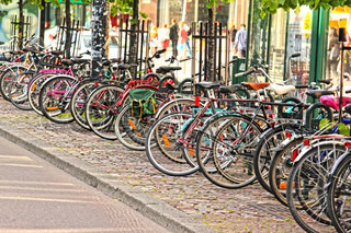Bikes parked in the city, in a nice line into a rack