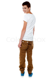 Trendy young boy turning back