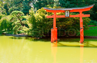Japanese garden and pond with a red zen tower stock for Japanese garden pool