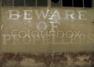 Beware of Propellers sign on the old aviation hangar door