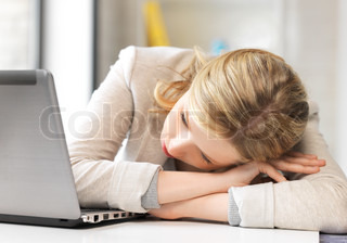 tired woman with laptop computer