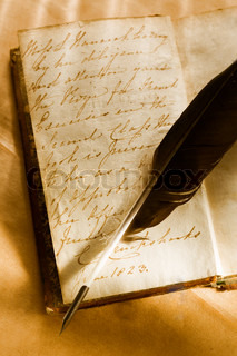 Old book with feather pen