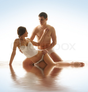 Young sexy couple isolated on white