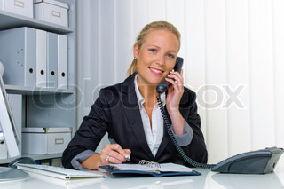 woman with a telephone in the office