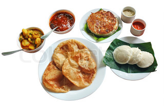 South indian morning breakfast and lunch comprising of dosa or uttapam, idli, poori, chutney, sambar and subzi isolated on white with clipping path
