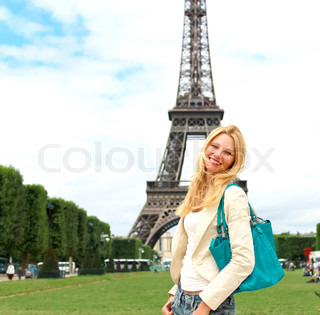 Vacation in paris lucky girl near the eiffel tower stock photo