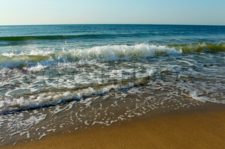 Surf on the shore of the Black Sea Ukraine in summer sunny day