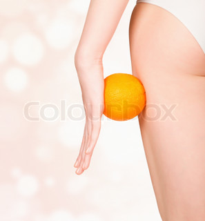 beautiful female figure with an orange, pastel blurred background
