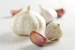 Fresh garlic on kitchen table. Garlic closeup on vintage wooden table