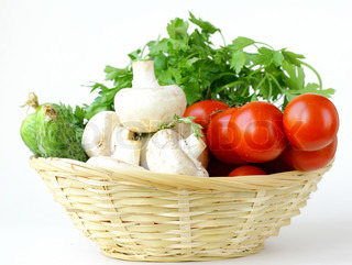 mushrooms, cucumbers, tomatoes and herbs in a basket