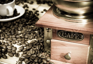coffee beans, cup and grinder on sack