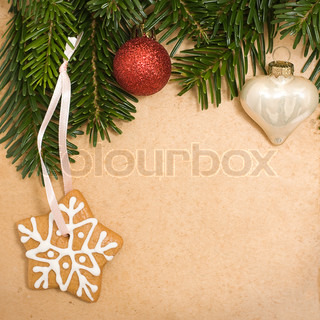 Vintage Christmas background with green fir tree, cookies and xmas decoration