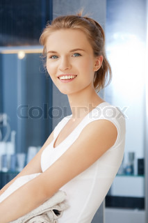 smiling teenage girl with towels