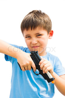 A Little Boy Playing With Toy Gun Stock Photo Colourbox