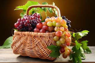Basket with pink and black grapes