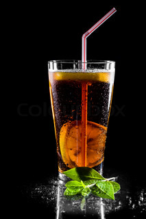Fresh cola drink with limes Isolated on black background